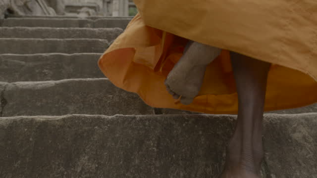 monk walks up steps at yapahuwa, sri lanka. - sri lankan culture stock videos & royalty-free footage