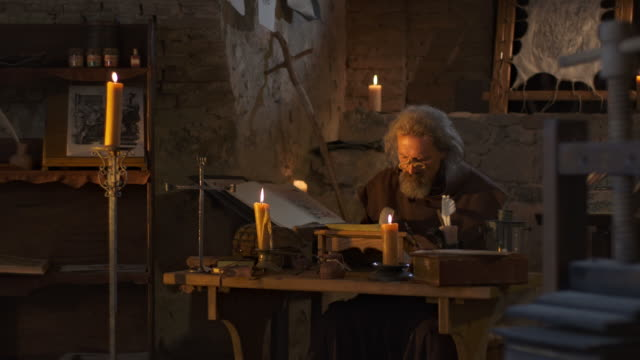 hd dolly: monk writing with a quill pen - medieval stock videos & royalty-free footage
