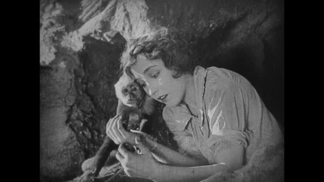1925 monkey climbs cliff face to take rope to stranded explorers - 1925 stock videos & royalty-free footage