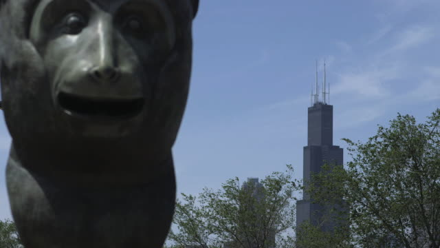 a monkey sculpture and the willis tower, chicago - willis tower stock videos and b-roll footage