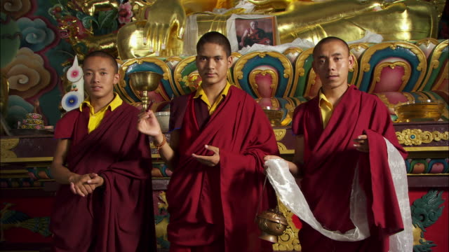 monks pose in front of an altar. available in hd. - altar stock videos & royalty-free footage