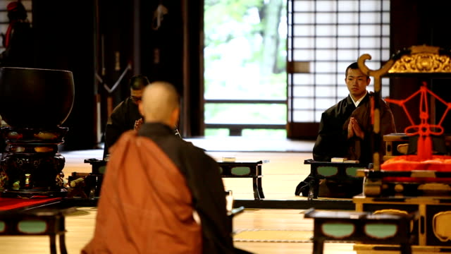 monks praying in a buddhist temple - shrine stock videos & royalty-free footage