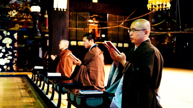 Monks praying in a Japanese temple