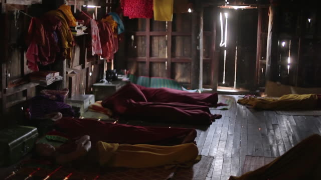 ws monks sleeping next to each other on floor / inle lake, shan state, myanmar   - other stock videos & royalty-free footage