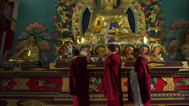 monks stand at an altar at the kagu college of monks. available in hd. - altar stock videos & royalty-free footage