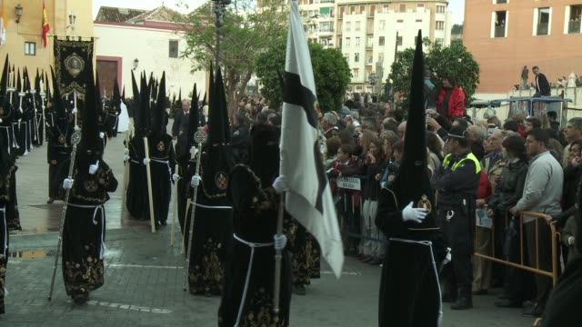monks walk in the procession for holy week in malaga. - holy week stock videos & royalty-free footage