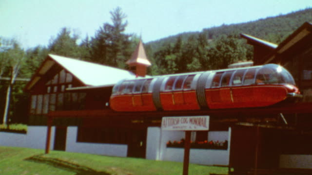 monorail and lodge / ski trail map / scenic shots and gondola lift / wild cat mountain on august 10 1968 in gorham new hampshire - ski lodge stock videos & royalty-free footage