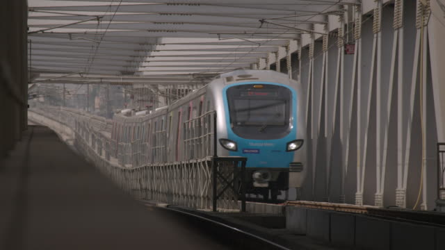 A monorail train approaches through a grey structure Mumbai Maharashtra India FKAD675A Clip taken from programme rushes ABQA810K