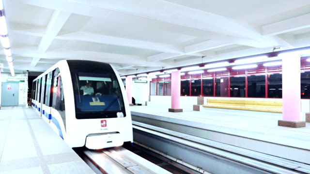 monorail train arriving to the station - railway station platform stock videos and b-roll footage