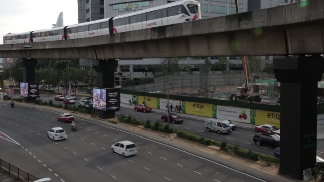 monorail train operated by rapid rail sdn bhd travels along an elevated track towards the bukit bintang station in kuala lumpur malaysia on friday... - kuala lumpur stock videos & royalty-free footage