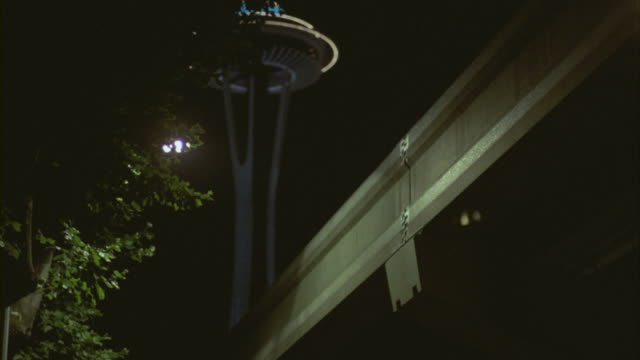 A monorail train passes below the Space Needle in Seattle.