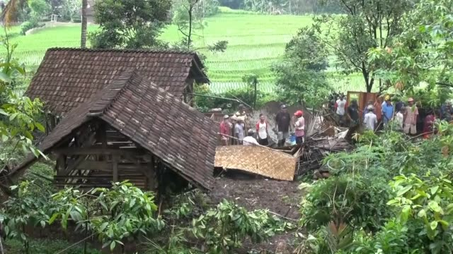 Monsoon rains trigger landslide in many regions of Jakarta Indonesia on 5 December 2014 Tens of houses are damaged and trees and lamppost toppled No...