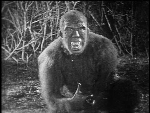B/W 1925 monster ape-man (Bull Montana) looking at something offscreen + drooling