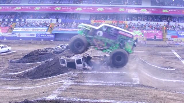 monster cars compete and perform in the auto parts monster jam at the ricardo saprissa stadium in san jose, costa rica on may 15, 2011. san jose, san... - san jose costa rica stock videos & royalty-free footage
