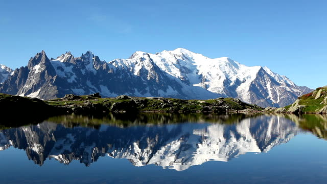 mont blanc reflection in lac blanc - mont blanc stock videos & royalty-free footage