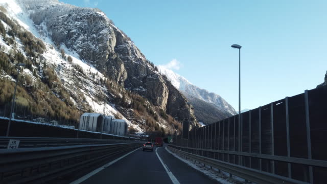 mont blanc - the tunnel in italy, car drivin pov - underpass stock videos & royalty-free footage