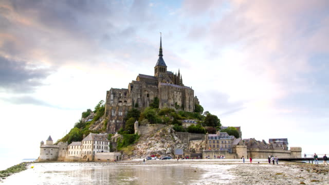mont saint michel abbey at sunset 4k timelapse, normandy, france. - tide stock videos & royalty-free footage