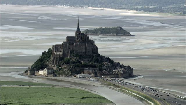 mont st michel  - aerial view - lower normandy,  helicopter filming,  aerial video,  cineflex,  establishing shot,  france - normandy stock videos and b-roll footage