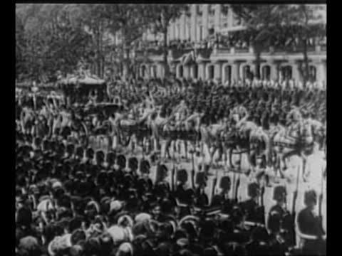 montage 1910 funeral procession of edward vii including prince george walking royal coach crowds lining streets / montage 6/22/1911 coronation of... - coronation stock videos and b-roll footage