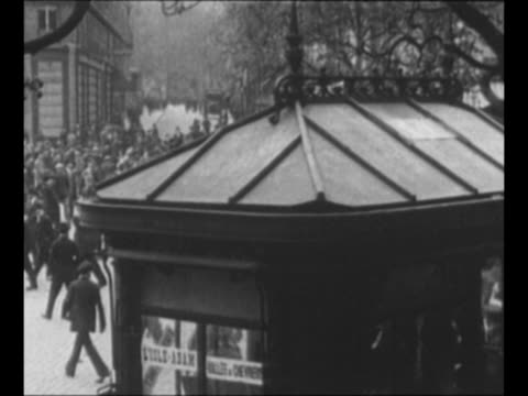 stockvideo's en b-roll-footage met montage 1920 riots in paris with crowds in streets police accosting and arresting rioters / montage crowds at 1921 antiamerican demonstration in rome... - 1921