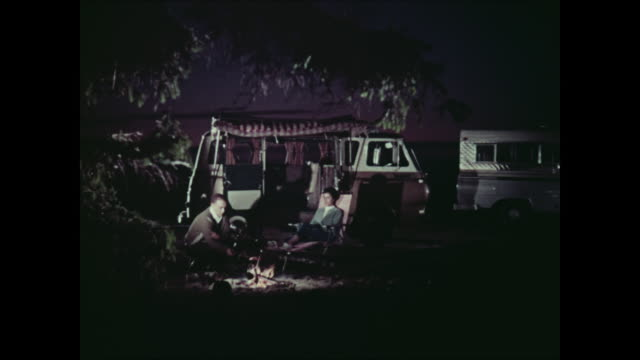 stockvideo's en b-roll-footage met montage: 1965 ford cars towing trailers - 1965