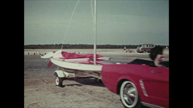 vídeos de stock e filmes b-roll de montage: 1965 ford mustang towing sailboat - 1964