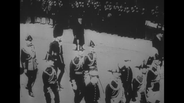 montage 5/17/1910 procession of edward vii including prince george walking with caisson crowds lining streets as coffin is transported to westminster... - coronation stock videos and b-roll footage