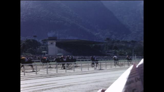 vídeos de stock, filmes e b-roll de montage: a horse race in brazil. - 1940