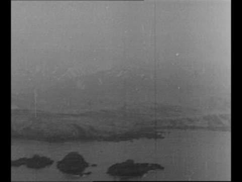 montage aerials aleutian islands / shoreline with landing crafts at edge of water - aleutian islands stock videos and b-roll footage