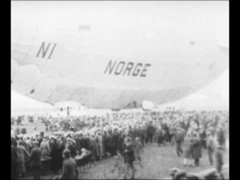montage airship norge used by explorers roald amundsen and lincoln ellsworth in race to fly over the north pole near hangar on ground and moving... - 1926 stock videos & royalty-free footage