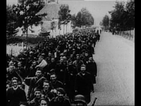 montage allied rear guard soldiers left behind at dunkirk during world war ii evacuation march as pows / sailor watches from camera ship in... - evakuierung von dünkirchen stock-videos und b-roll-filmmaterial