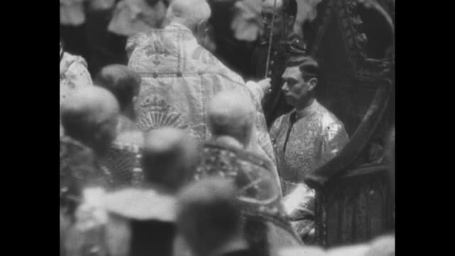 montage archbishop of canterbury presents king george vi with the sword in the purple scabbard during coronation ceremony at westminster abbey king... - coronation stock videos and b-roll footage