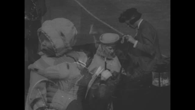 montage baby princess elizabeth in nurse's arms in 1926 / king george vi, wearing kilt, gets out of car, assists queen mary as she decars; valet... - elizabeth ii stock videos & royalty-free footage