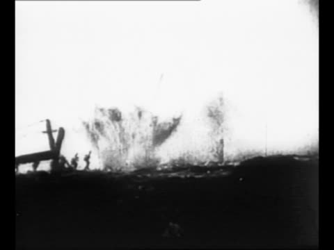 montage battle scenes from world war i with soldiers advancing line of explosions gun shooting out of window one soldier shot as another advances... - artiglieria video stock e b–roll