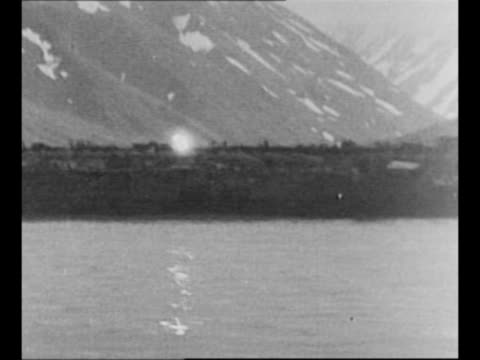 montage battleship fires guns as protective cover for us troops landing on attu island during world war ii / fire from strike on shore / japanese... - landing craft stock videos & royalty-free footage