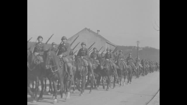 montage belgian cavalry approaches passes / cu directional sign gives distances to belgian german towns / pan valley with town / note exact month/day... - directional sign stock videos & royalty-free footage