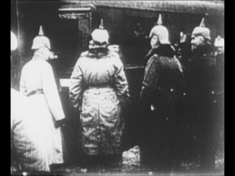 montage bolshevik revolutionary leon trotsky speaks from train car as soldiers train personnel and spectators stand nearby / trotsky shakes hands... - 1918 stock videos & royalty-free footage