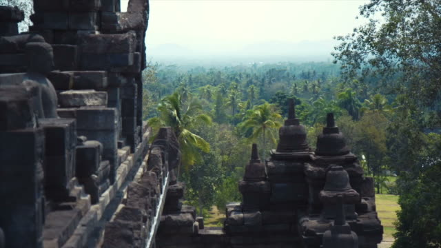 Montage - Borobudur temple with Buddha head