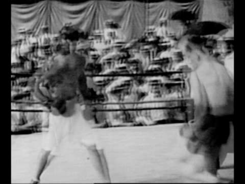 montage boxer jack dempsey in match with other boxer / trainer wipes down dempsey / from greatest headlines of the century series - sporting footwear stock videos & royalty-free footage
