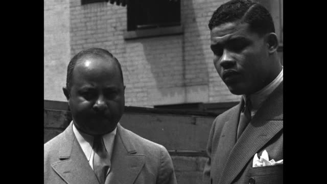 stockvideo's en b-roll-footage met montage boxer joe louis stands with his manager john roxburgh outdoors / montage cu louis / sot roxburgh and sot louis conversation about potential... - sportkampioenschap