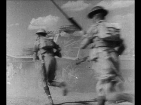 montage british infantrymen run, pass tank, pass corpses on ground as they advance at el alamein in world war ii / jeeps move away through desert /... - britisches militär stock-videos und b-roll-filmmaterial