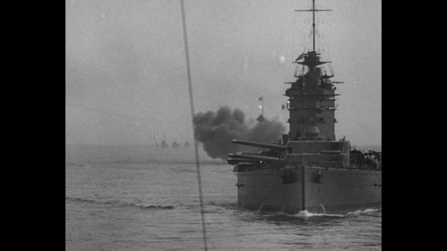 montage british navy battleships sail, fire guns as they conduct gunnery maneuvers as part of military review by king george v / from observation... - battleship stock videos & royalty-free footage