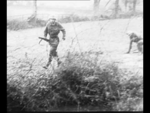 montage british soldiers run across field, in brush area with bayoneted rifles in front of them, during commando training during world war ii /... - trench stock videos & royalty-free footage
