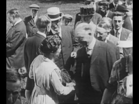 montage calvin coolidge and wife grace greet crowd in front of his massachusetts home as he campaigns for us vicepresidency in 1920 crowds wave as... - eastern usa stock videos and b-roll footage
