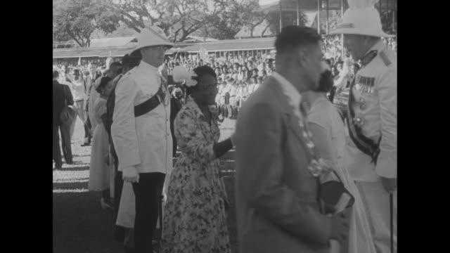 montage car bearing princess margaret arrives in arima, trinidad, as the princess continues her caribbean tour / crowds wave, cheer / montage... - trinidad trinidad and tobago stock videos & royalty-free footage