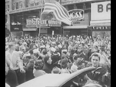 Montage celebration in San Francisco CA at the news of Japanese surrender in World War II marquee war ends waving and happy crowds under Victory sign...