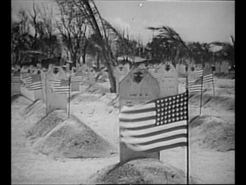 montage cemetery with graves of us marines killed during world war ii battle of saipan; small flags flutter in breeze as they stand atop each grave /... - the world's end stock videos & royalty-free footage