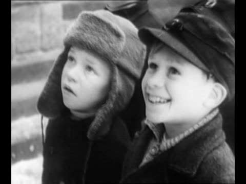 montage children stand in line near a truck dispensing schoolbooks during allied occupation of germany snow lies on ground / two young boys one... - prisoner education stock videos & royalty-free footage