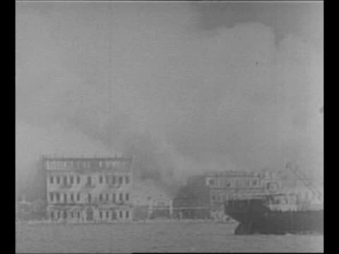 montage city of smyrna burns during greco-turkish war / montage refugees in small boats in water reach foreign gunboats offshore / night: montage... - 1920 stock-videos und b-roll-filmmaterial
