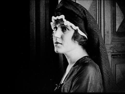 1916 b/w montage close up/ woman/ clergyman/ worried woman looking at camera - conspiracy stock videos and b-roll footage
